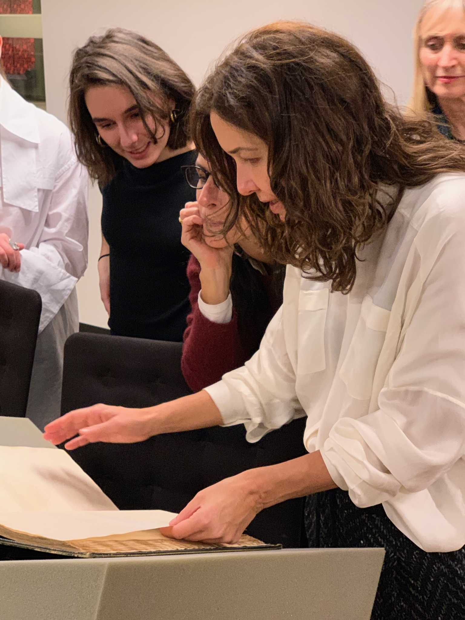 Adriana Varejão inspects an item from Firestone Library's Rare Books Collection