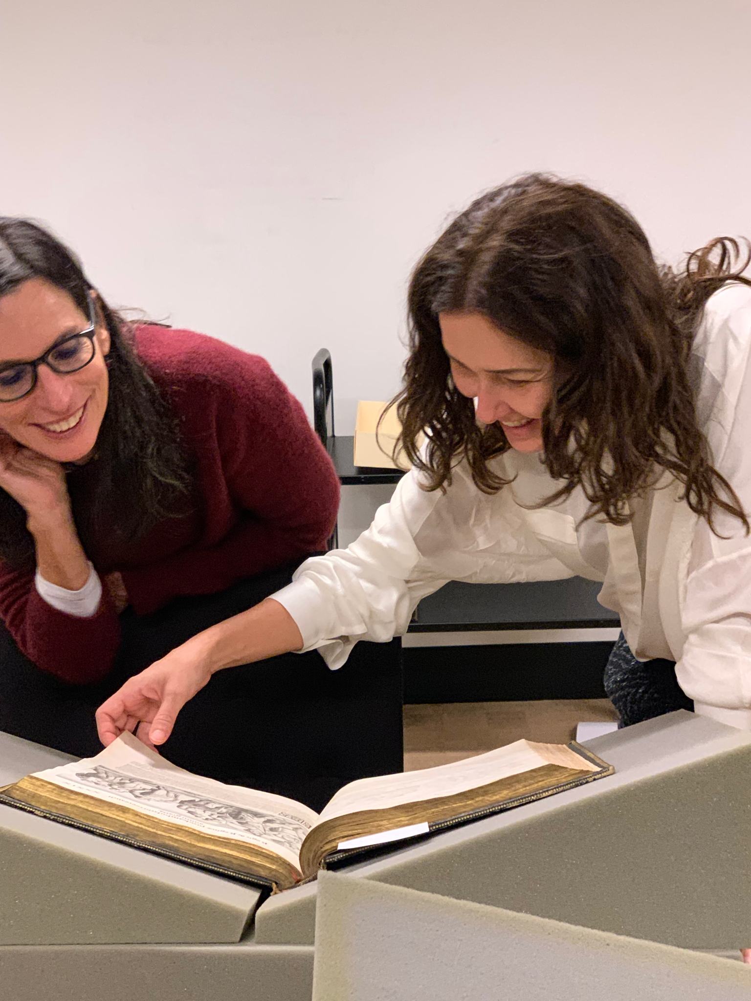 Lilia Schwarcz and Adriana Varejão inspect an item from Firestone Library's Rare Books Collection.