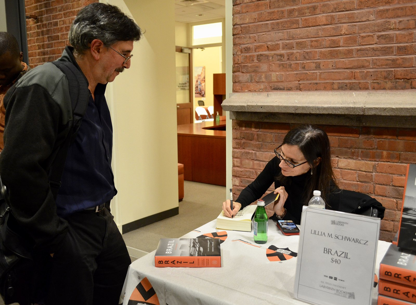 lilia Schwarcz signs copies of her book, Brazil: A Biography.