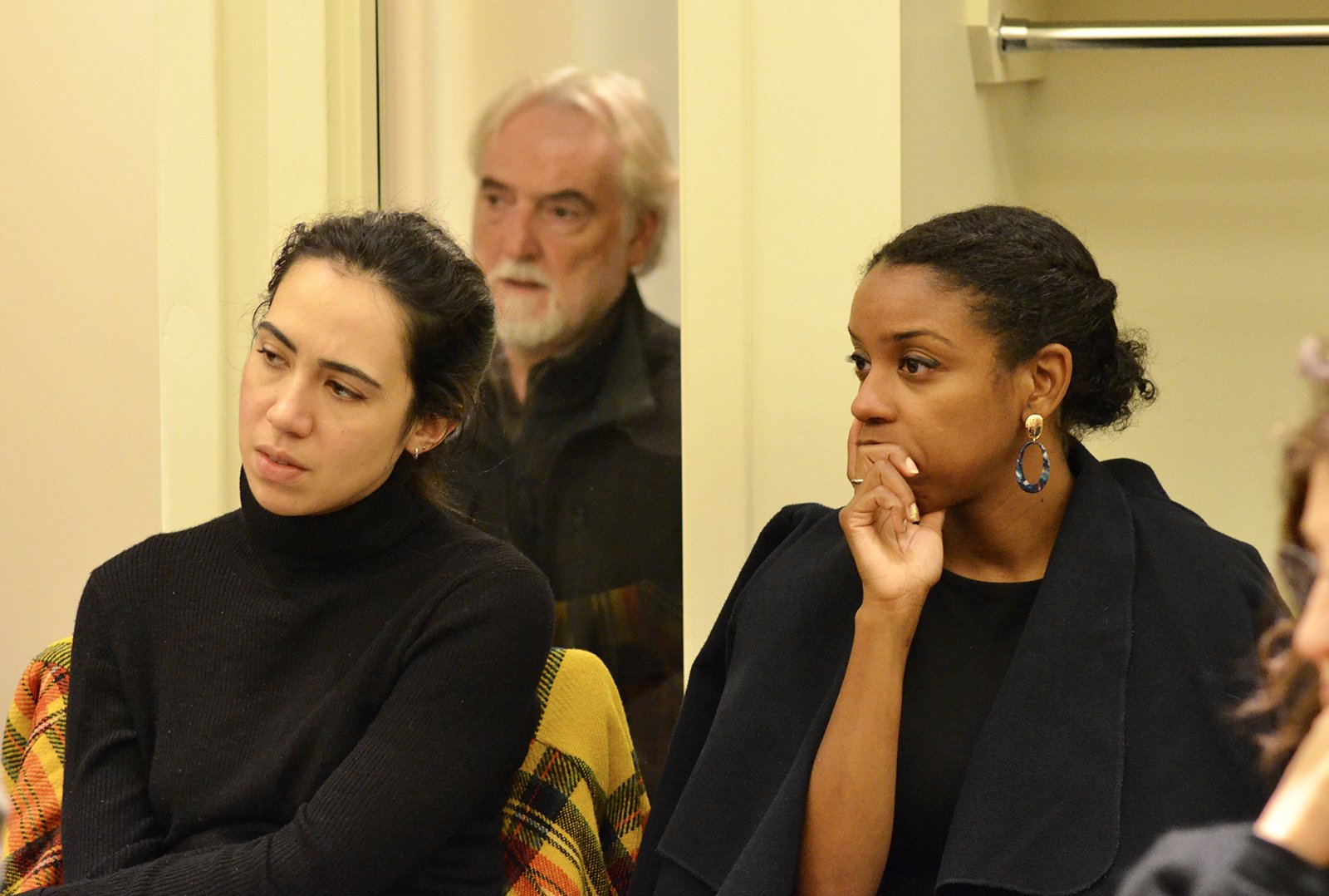 Attendees listen to the discussion.