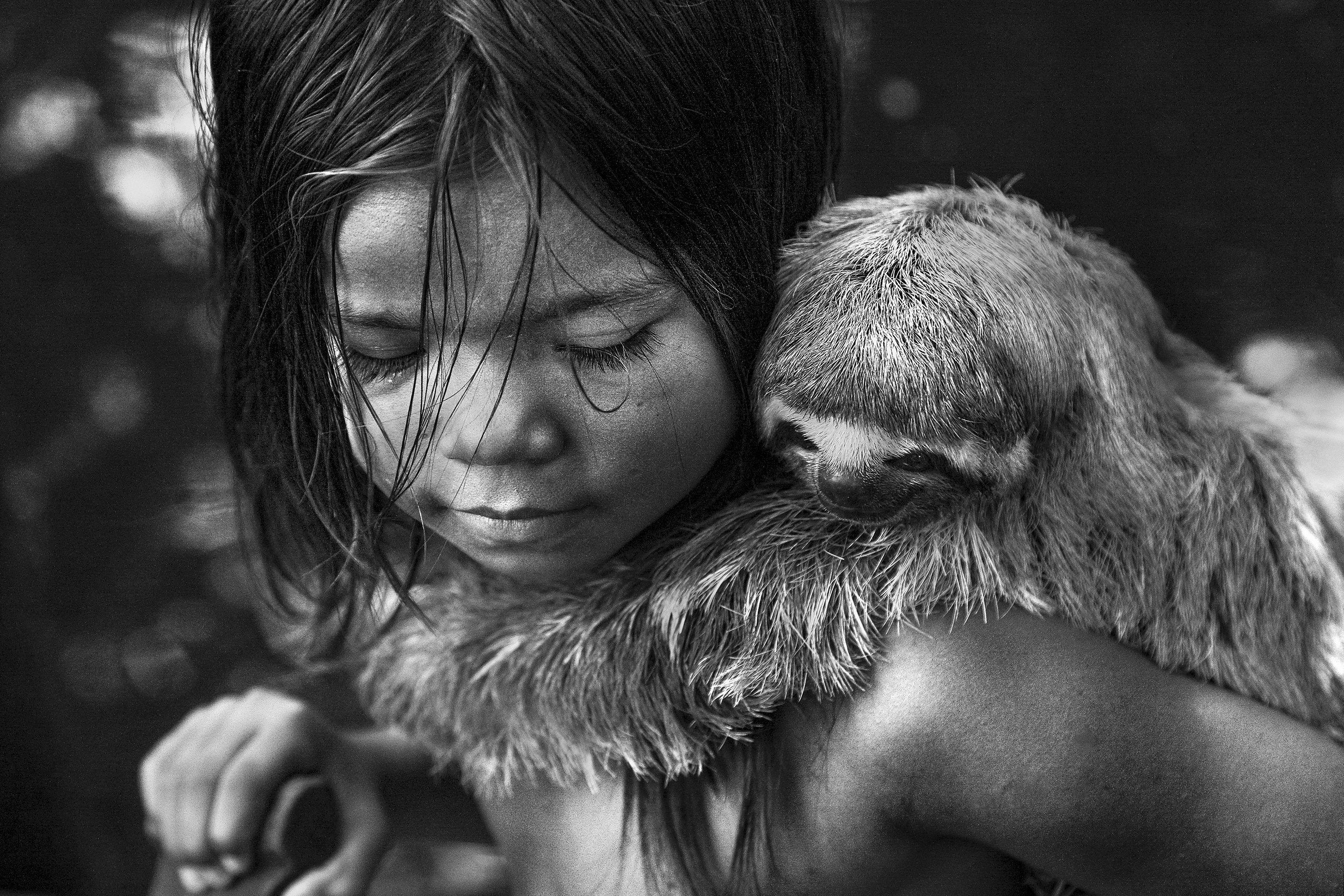 Indigenous girl with a monkey by Araquem Alcantara